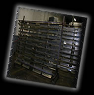 We hang many parts on our unique powdercoating parts racks!